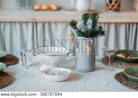 Christmas Decorations. Fir Branches With Snow Inside The Vase On The Christmas Table. Decoration Of