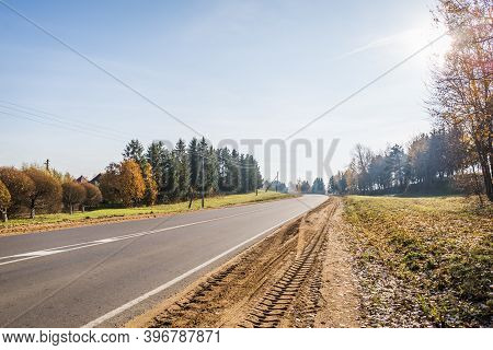 Empty Turning Rural Highway Under Blue Sky In Sunny Autumn Day With Copy Space. European Roadway Lan