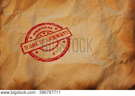 Made In Germany Stamp On Crumpled Sheet Of Burnt Paper. Deutsche Product, Parcel, Package, Productio