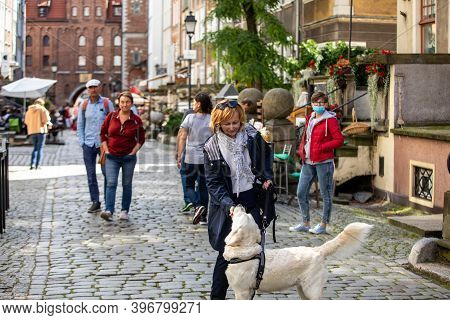 Gdansk, Poland - Sept 6, 2020: Group Of People On Mariacka Street, The Main Shopping Street For The