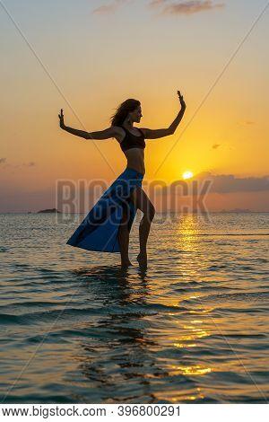 Young Beauty Girl Dancing At Tropical Beach On Sea Water At Paradise Island At Sunset, Close Up. Sum
