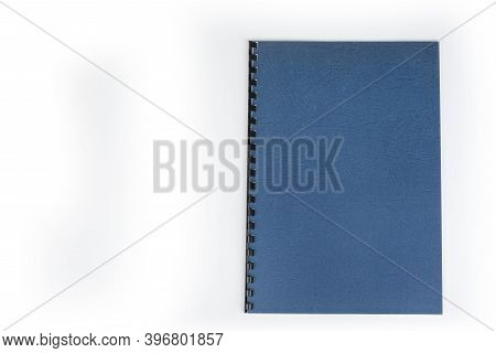 Closed New Notebook With  A Binding On A White