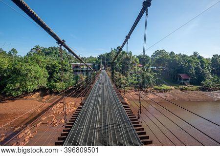 The Suspension Bridge Over River, Surat Thani, Thailand