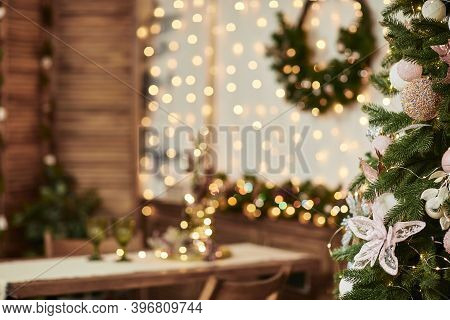 Christmas Tree On Blur Background Of Christmas Decorated Interior. Copy Space For Text