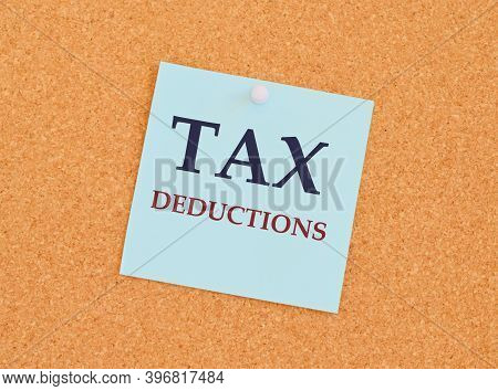 Writing Text Showing Tax Deductions. Business Concept For Finance Incoming Tax Money Deduction Writt