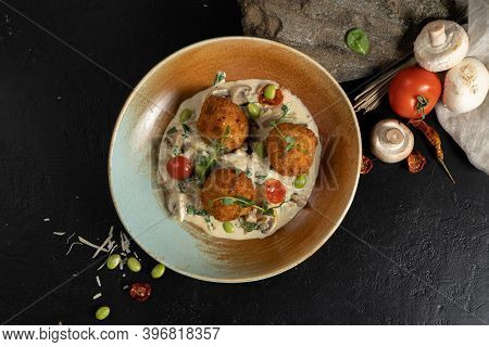 Meatballs With Mushroom Cheese Sauce, Beans And Herbs. Three Round Chicken Or Pork Cutlets Or Meatba
