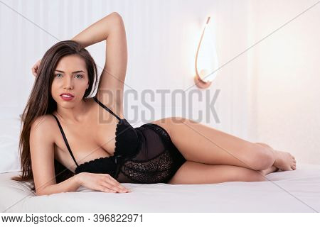 Sexy Young Woman Posing On The Bed, Sexy Photos Concept