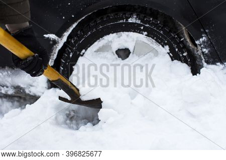 Car, Winter, People And Vehicle Concept - Close-up Of A Man, Cleans A Car From A Snow Shovel