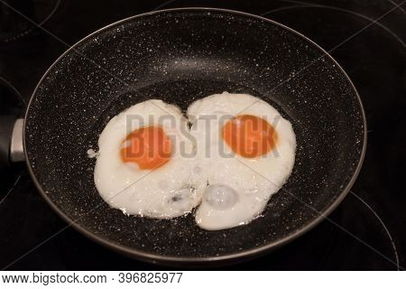 Chicken Eggs In Frying Pan. Fried Eggs In A Cast Iron Pan Close-up, Breakfast, Omelet, Two Eggs With