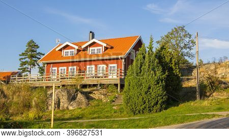 Red Cottages On The Island Harstena In Sweden, Principally Known For The Seal Hunting That Was Once