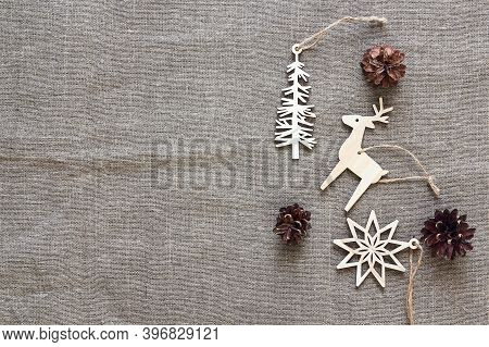 Vintage Wooden Christmas Decorations With Cones On Sackcloth. Space For Text. View From Above.
