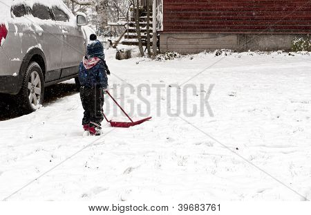 Helpful Young Boy Shoveling Snow