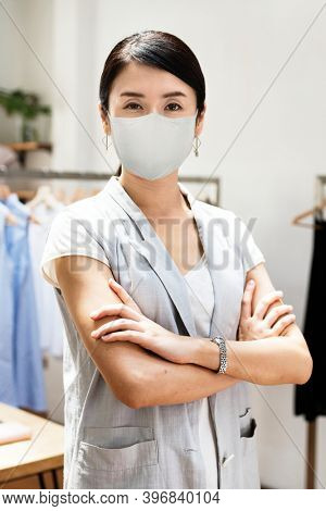 Retail's new normal, employee wearing mask covid 19