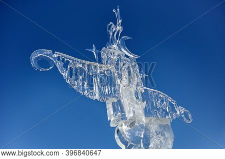 abstract ice sculpture against the blue sky.