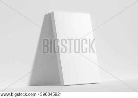 Blank White Empty Rectangular Poster On Floor Leaning At Empty White Wall, Diagonal View, White Blea