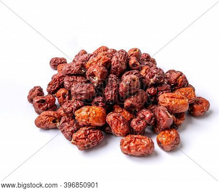 Dried Jujube Isolated On White Background. The Fruit Is A Traditional Chinese Herb. Dried Jujube Can