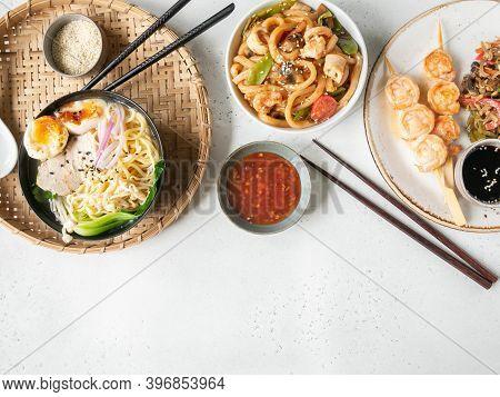Set Asian Food - Ramen Soup, Grilled Shrimp, Stir Fry Vegetables And Udon With Seafood White Backgro