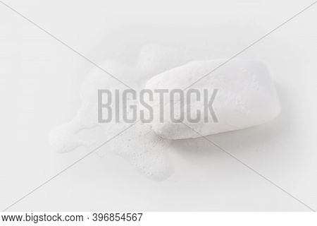 Soap With Foam On A White Background Soap Used In Everyday Life, Including Washing, Bathing