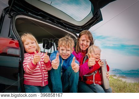 Happy Mother With Kids Travel By Car Near Beach