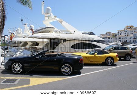 Luxury Cars In The Car Park Of The Yacht Club Of Marbella, Spain