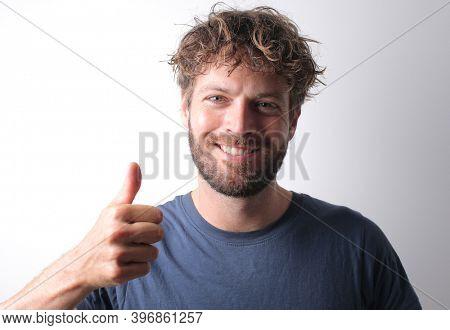 portrait of man with raised thumb