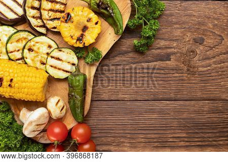 Close-up Of Grilled Organic Vegetables On A Wooden Cutting Board On The Table. Fried Cornmeal, Eggpl