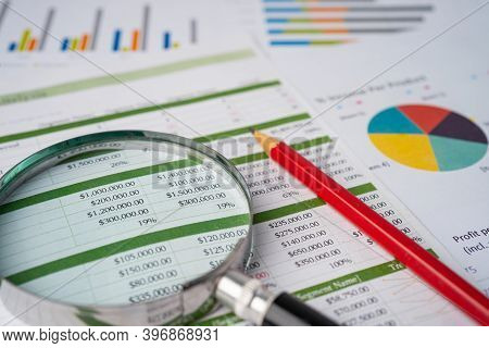 Magnifying Glass With Pencil On Spreadsheet Table And Graph Paper; Finance Development, Banking Acco