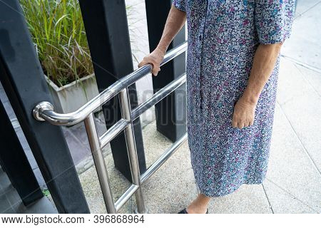 Asian Senior Or Elderly Old Lady Woman Patient Use Slope Walkway Handle Security With Help Support A