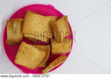 Stack Of Plain Melba Toasts On White Background. Edible Square Dry Toast Slices. Delicious Crispbake