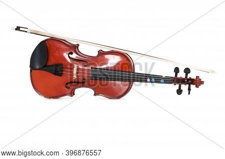 A Viola And Bow Isolated Against A White Studio Background.
