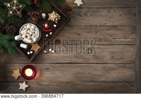 Christmas Composition With Hot Drink, Marshmallow, Gingerbread Cookies And Candles On  Wooden Table,