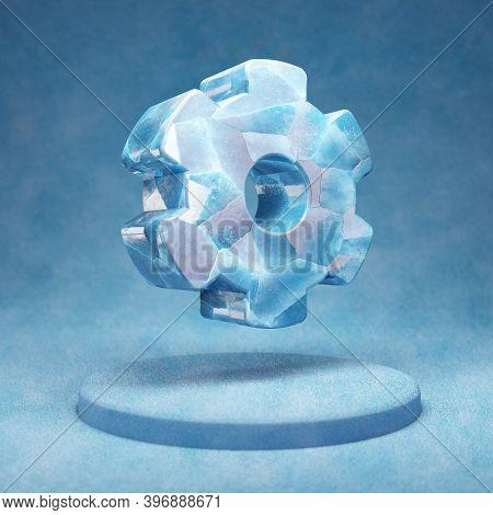 Cog Wheel Icon. Cracked Blue Ice Cog Wheel Symbol On Blue Snow Podium. Social Media Icon For Website