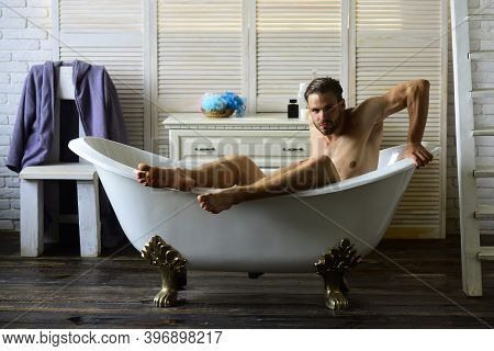 Guy In Bathroom With Toiletries, Chair And Stairs On Background