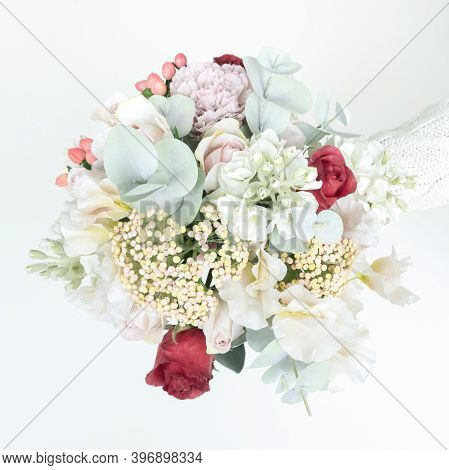 Delicate Wedding Bouquet In Pastel Shades From Artificial Flowers Top View Close-up. A Spare Bridal