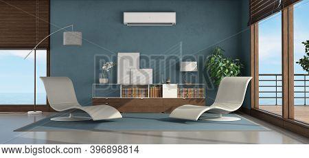 Living Room Of A Seaside House With Two Chaise Lounge,sideboard And Air Conditioner On The Blue Wall