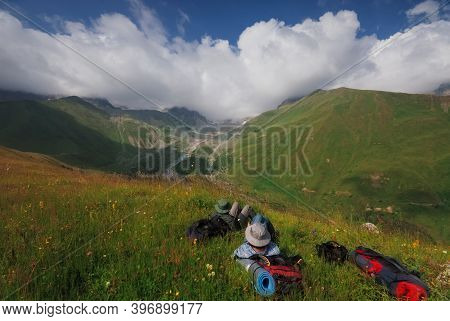 Georgia, Racha - August 17, 2013: The Traveling Girl Rests Against The Backdrop Of An Amazing View.