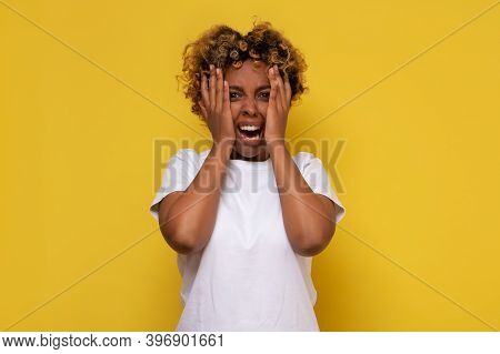 African American Woman With Hand On Head For Pain In Head Because Of Stress Suffering Migraine.