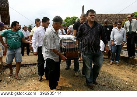 Pau Brasil, Bahia, Brazil - February 2, 2012: People Are Seen During A Person\'s Burial At The Cemet