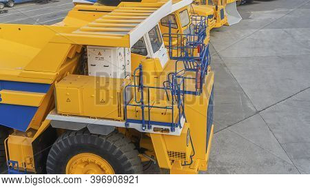 Heavy Mining Dump Trucks Are At The Factory. Giant Mining Truck After Being From The Conveyor Is Tes