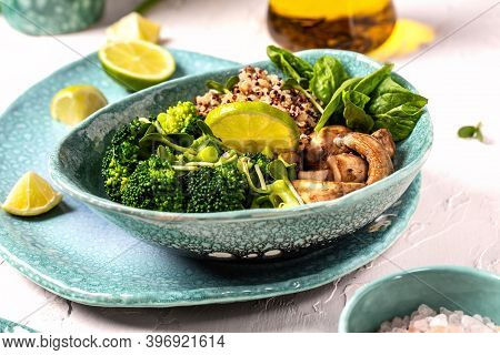 A Plate Of Nutritious Simple Salad With Mushrooms, Spinach, Broccoli And Quinoa. Superfood Concept.