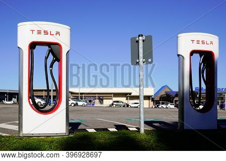 Bordeaux , Aquitaine  France - 11 21 2020 : Tesla Red Text Sign And Logo On White Charger Supercharg