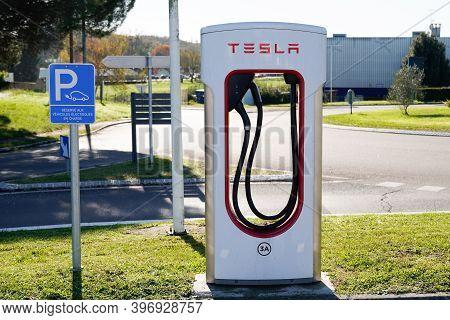 Bordeaux , Aquitaine  France - 11 21 2020 : Tesla Supercharger Car Parked Station Reserved For Elect