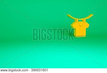 Orange Drying Clothes Icon Isolated On Green Background. Clean Shirt. Wash Clothes On A Rope With Cl
