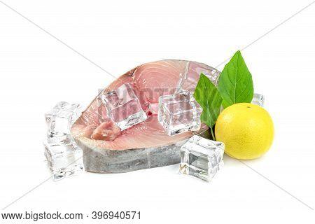 Spanish Mackerel Slice Or Spotted Mackerels With Lemon And Leaf Basil And Ice Cube Isolated On White
