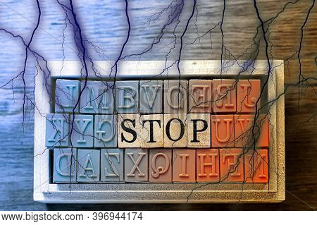 Stop - Isolated Abstract In Blue And Orange Wood Type Stamps And Black Lightning Or Thunder Against