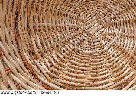 Handmade From A Vine, A Vine Braided In A Circle Concept Of A Background Or Texture. Wicker Spiral T