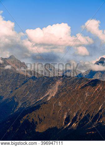 Beautiful Mountain Landscape. High-mountain Massif, Clouds Over Mountain Peaks. Harsh Mountain Peaks