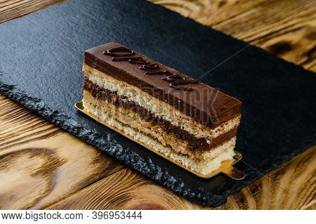Portion Of Layered Creamy Cake, Cake Layers On A Wooden Table