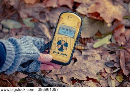 Checking Radiation Level With A Personal Dosimeter. Pripyat City In Chernobyl Exclusion Zone, Ukrain