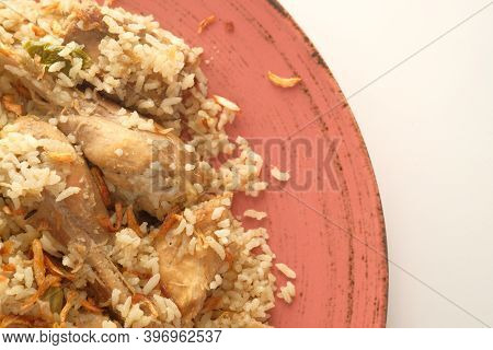 Chicken Biryani Meal In A Bowl On Table.